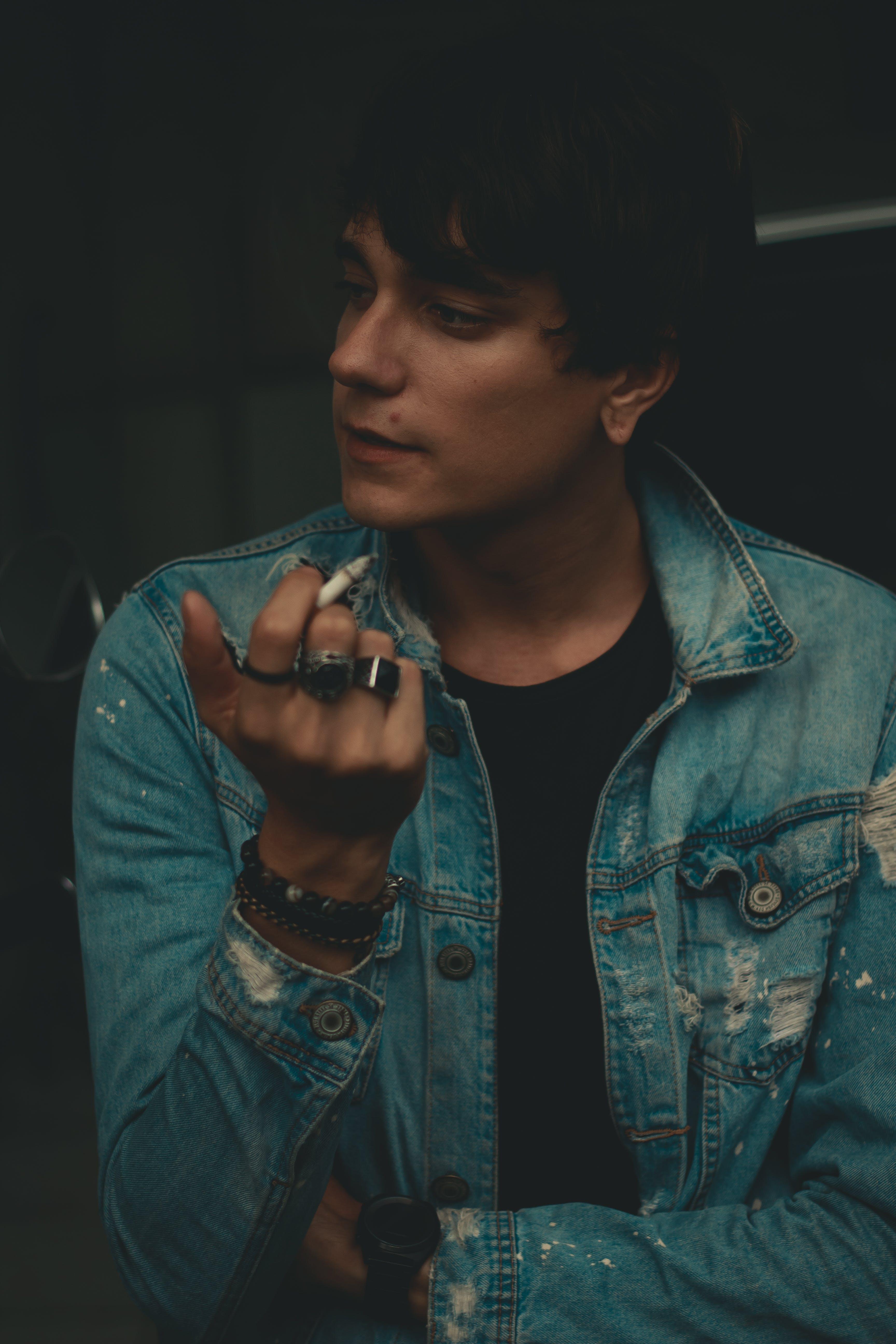 Man Holding Cigarette