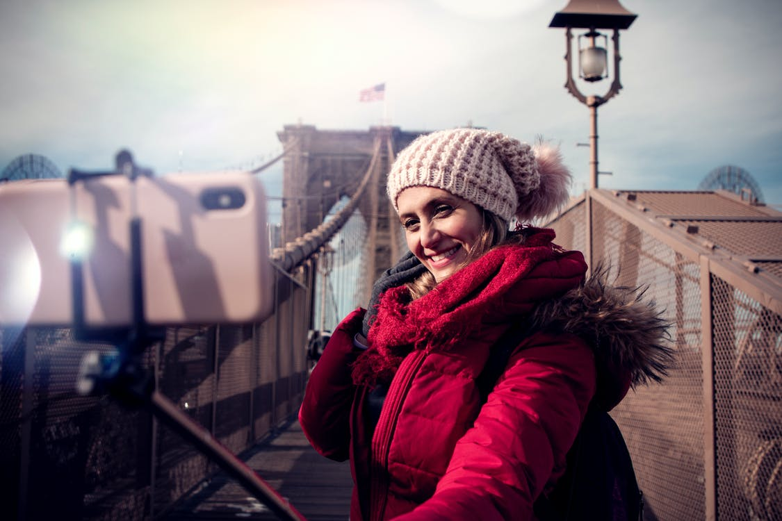 Woman Wearing Red Zip-up Hooded Jacket