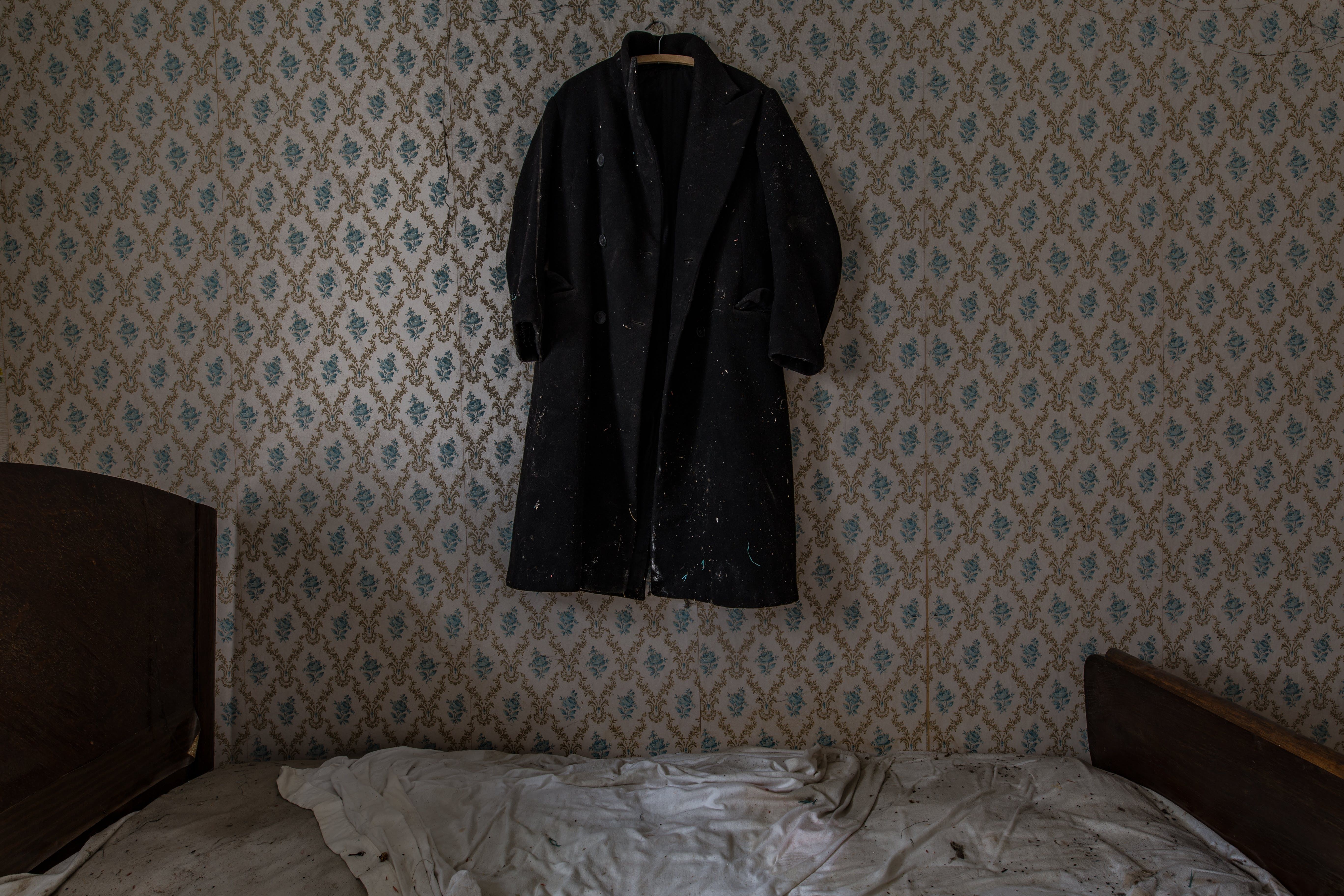 Black Coat Hanging on Wall