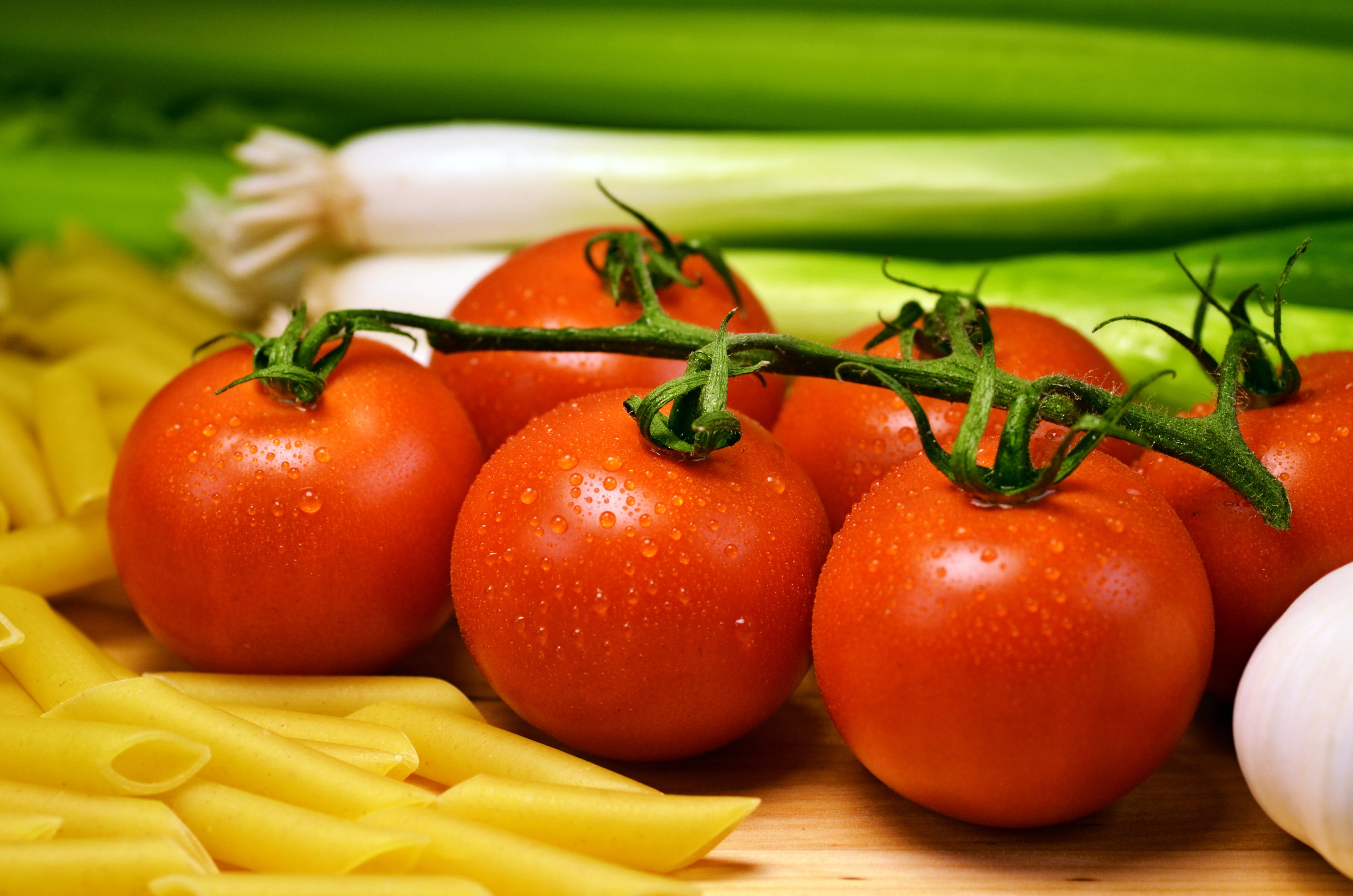 Close Up Photo of Red Tomatoes Near Pasta