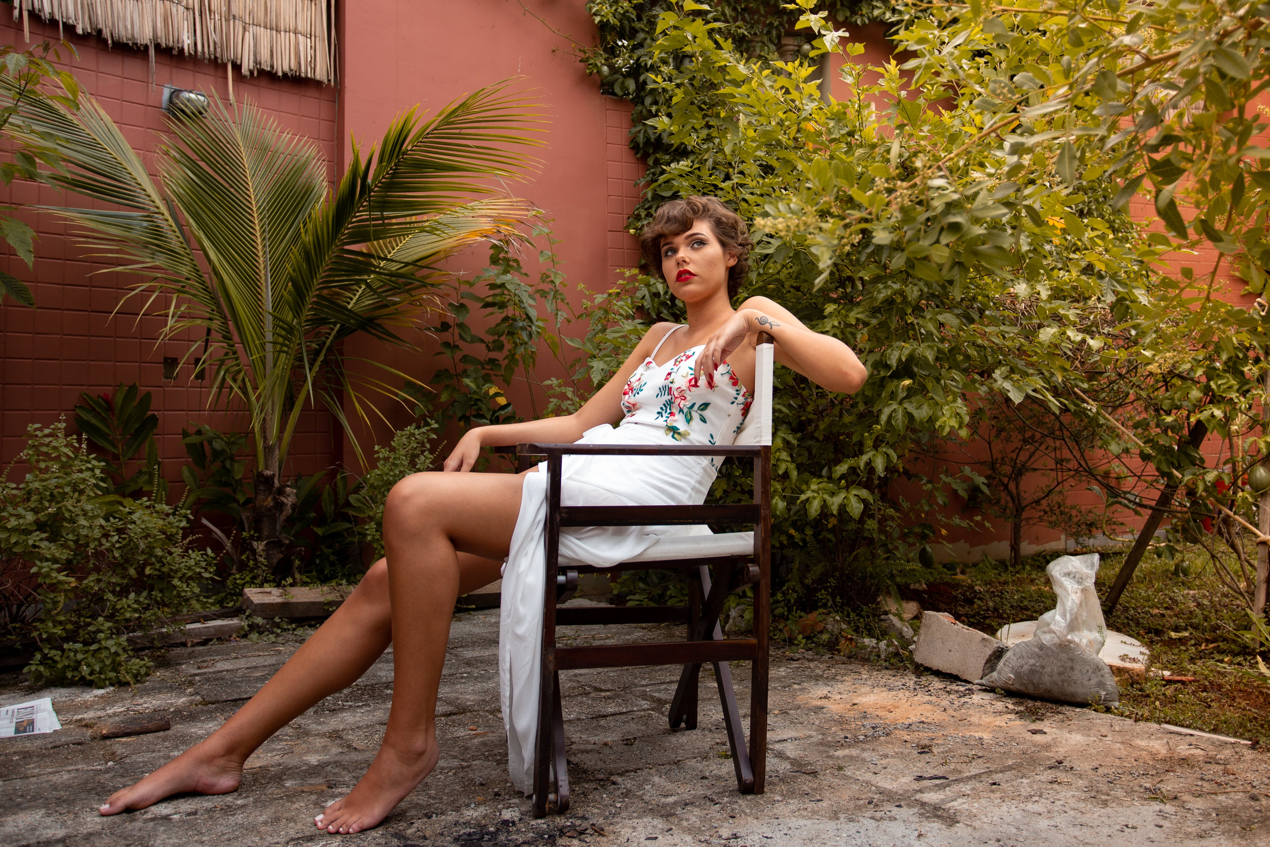 Woman Sitting on White and Brown Wooden Chair