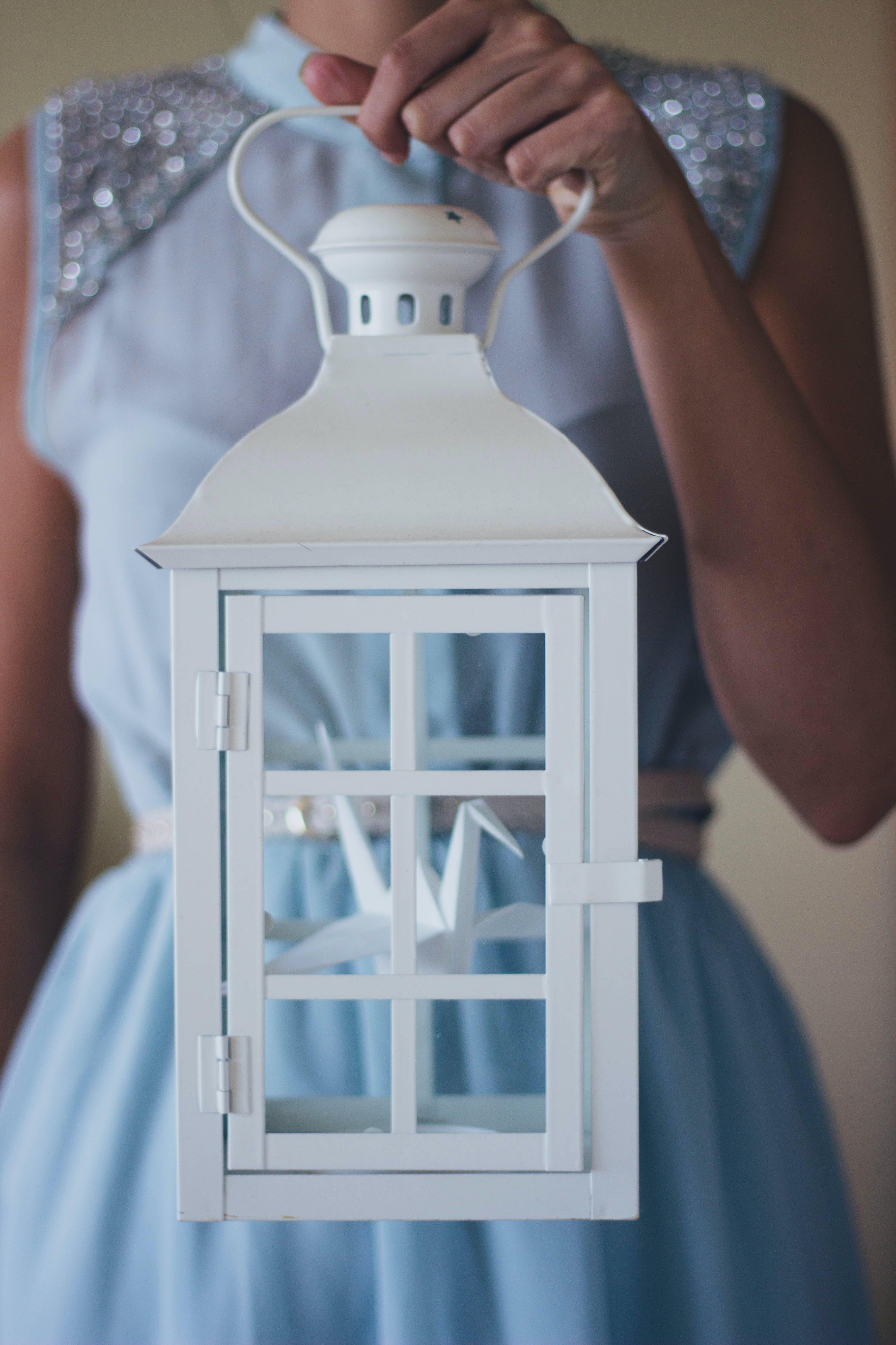Woman Holding White Lantern