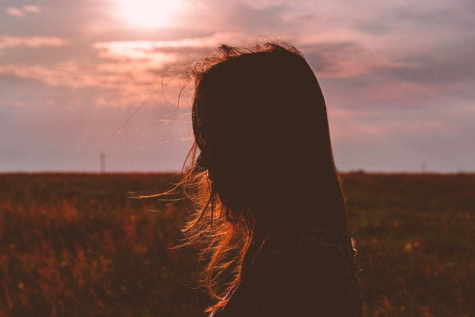 Woman's Silhouette Photo during Sunset