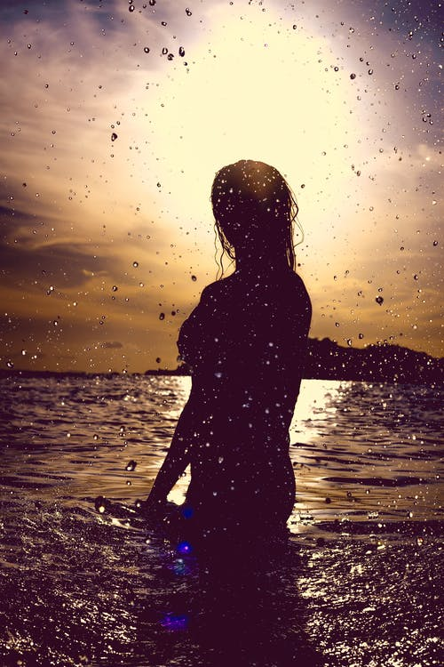 Silhouette of Woman in Water