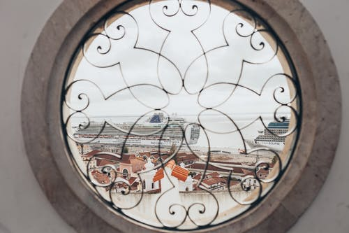 Round Window With View of Town