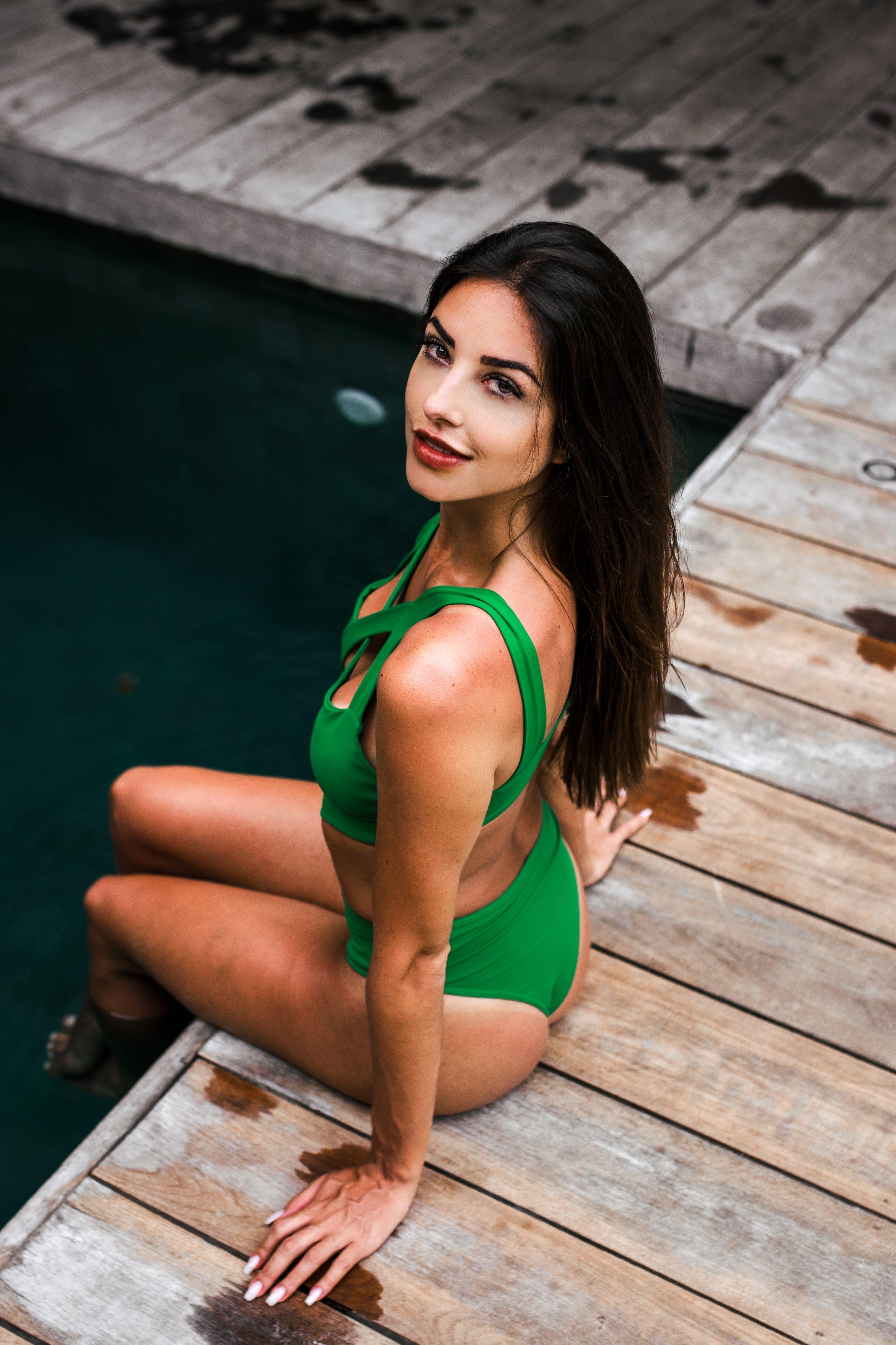 Photo of Woman Wearing Green Bikini