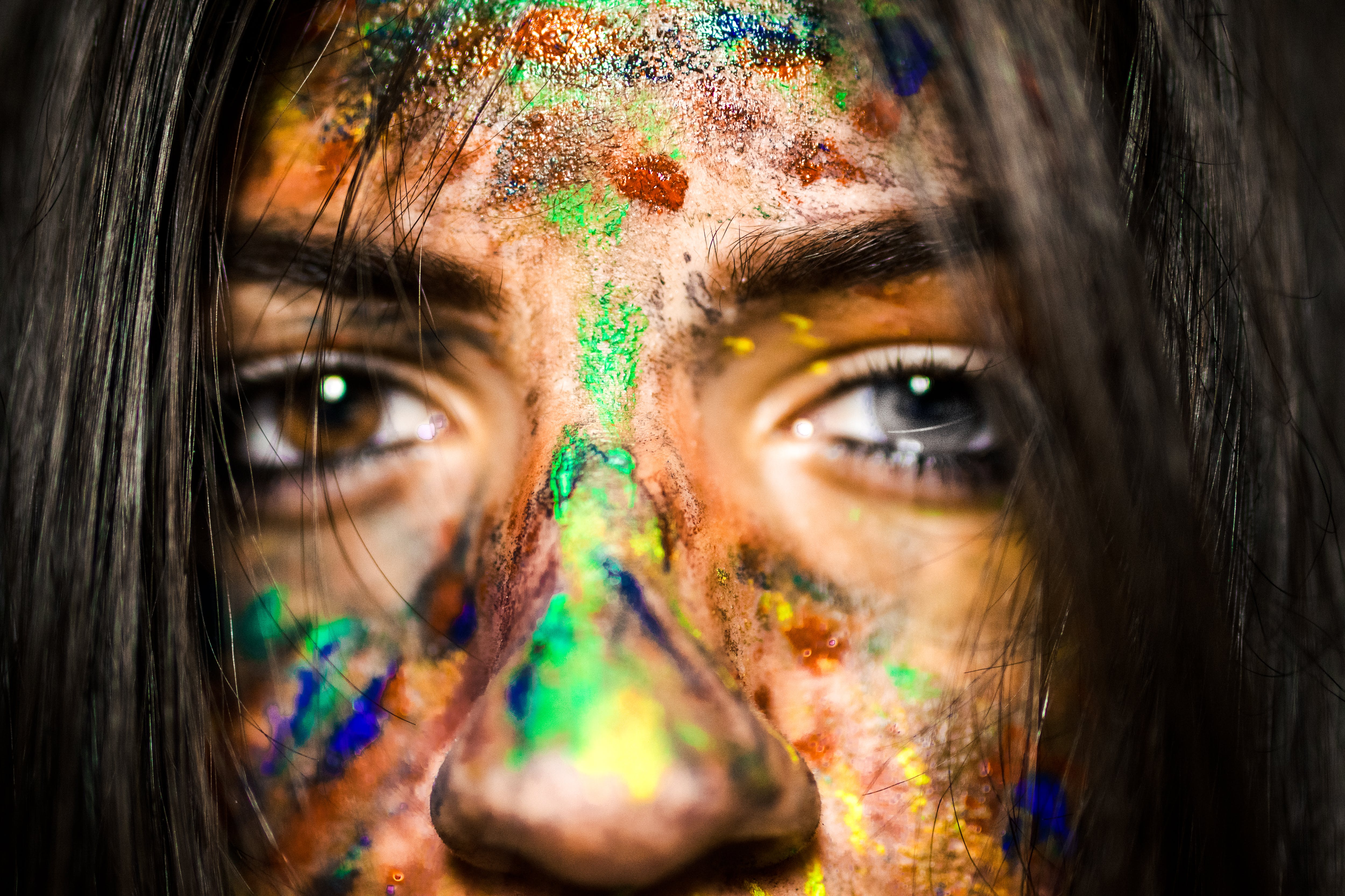Close-up Photo of Woman With Paint on Face