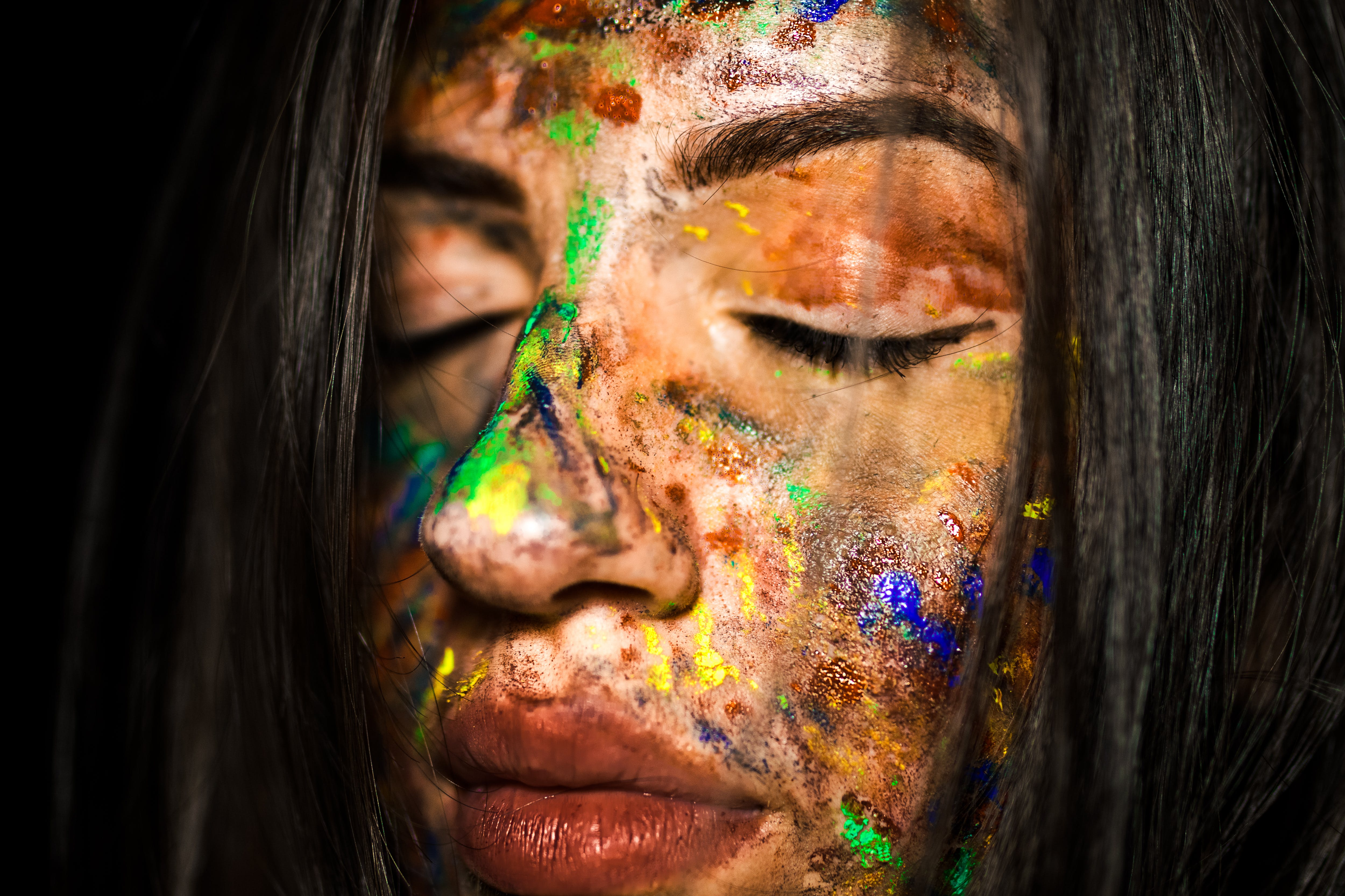 Close-Up Photo of Woman's Face With Paint