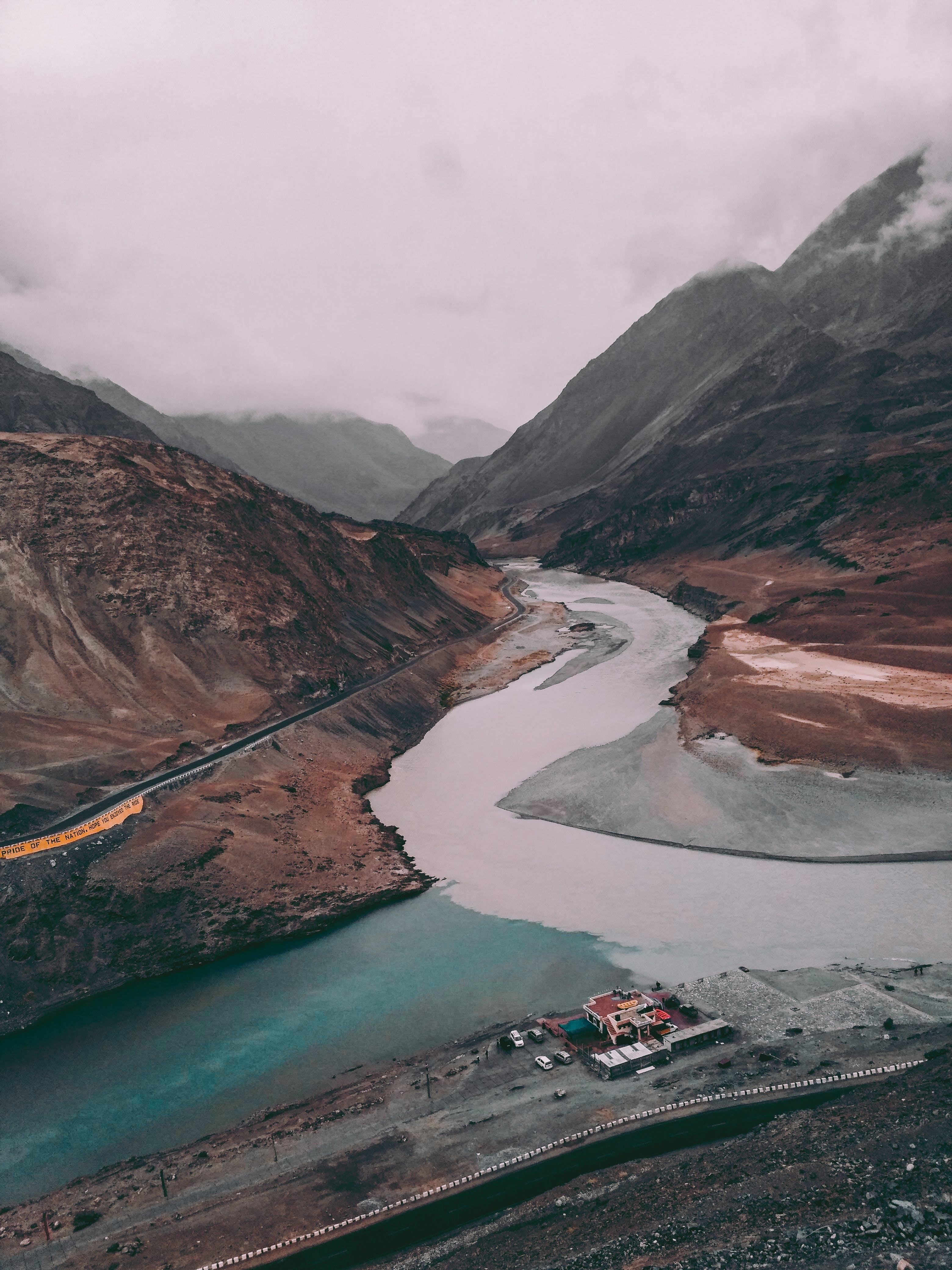 River in Between Two Roads