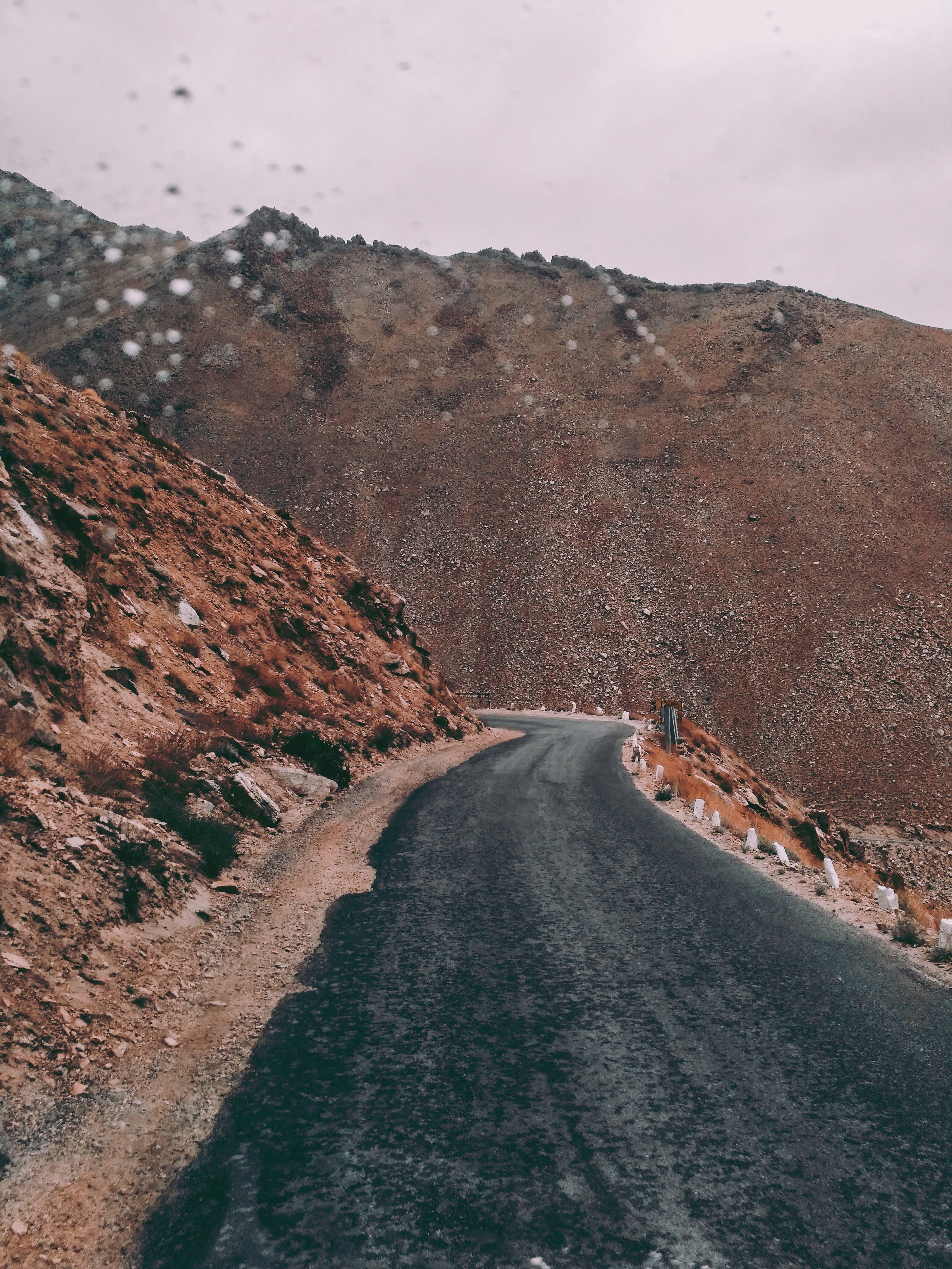 Asphalt Road Beside Rock Formation