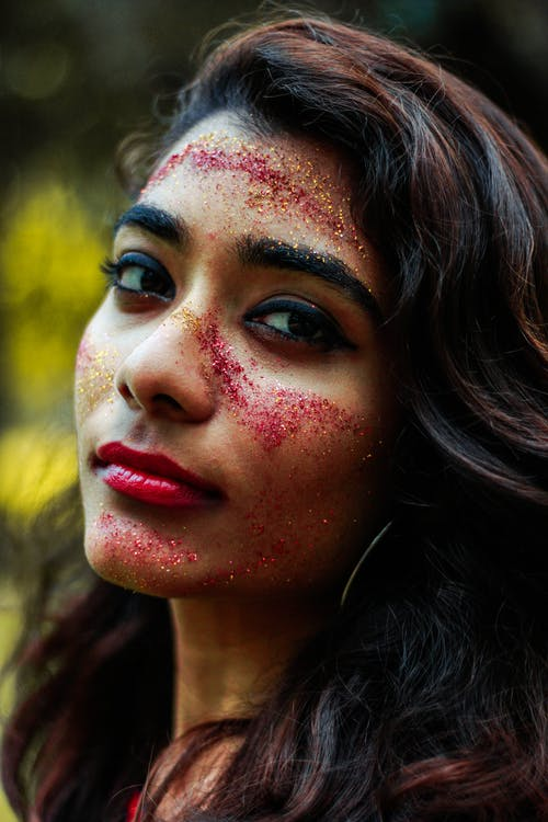 Close-Up Photo of Woman With Glitters On her Face