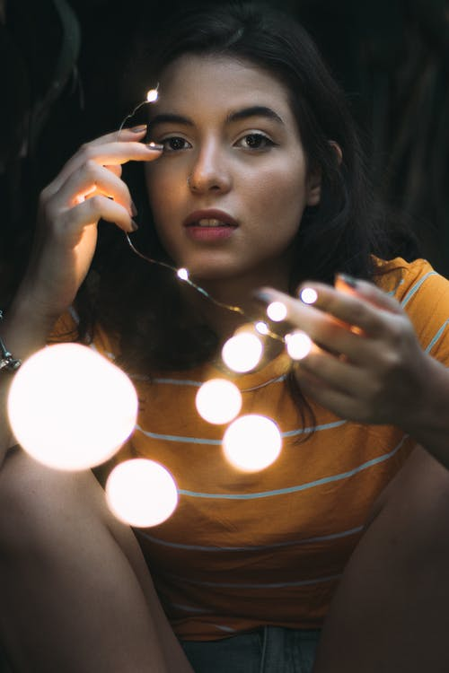 Photo of Girl Holding String Light