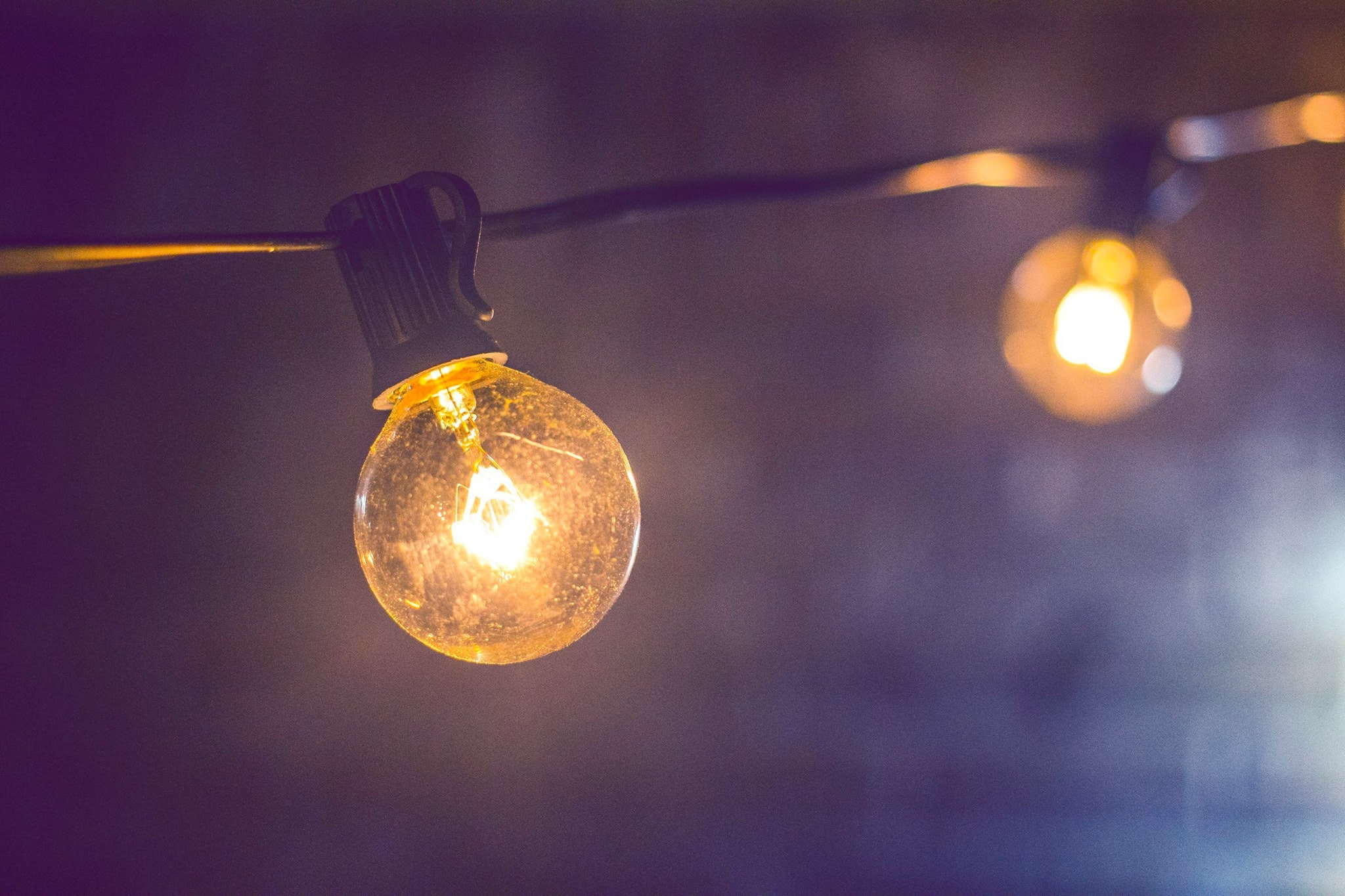 shallow focus photography of yellow string light free stock photo