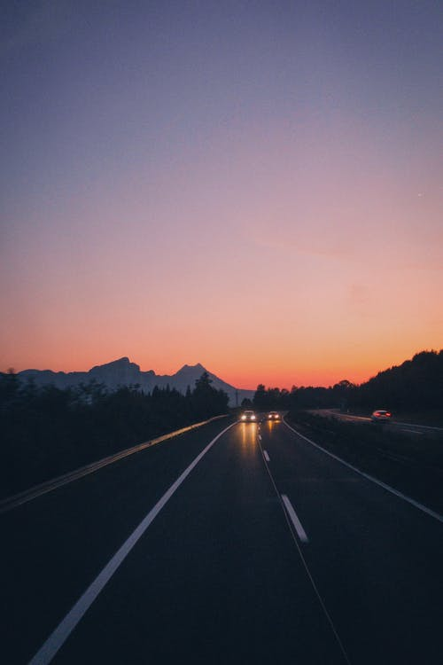 Scenic View Of Road During Dawn