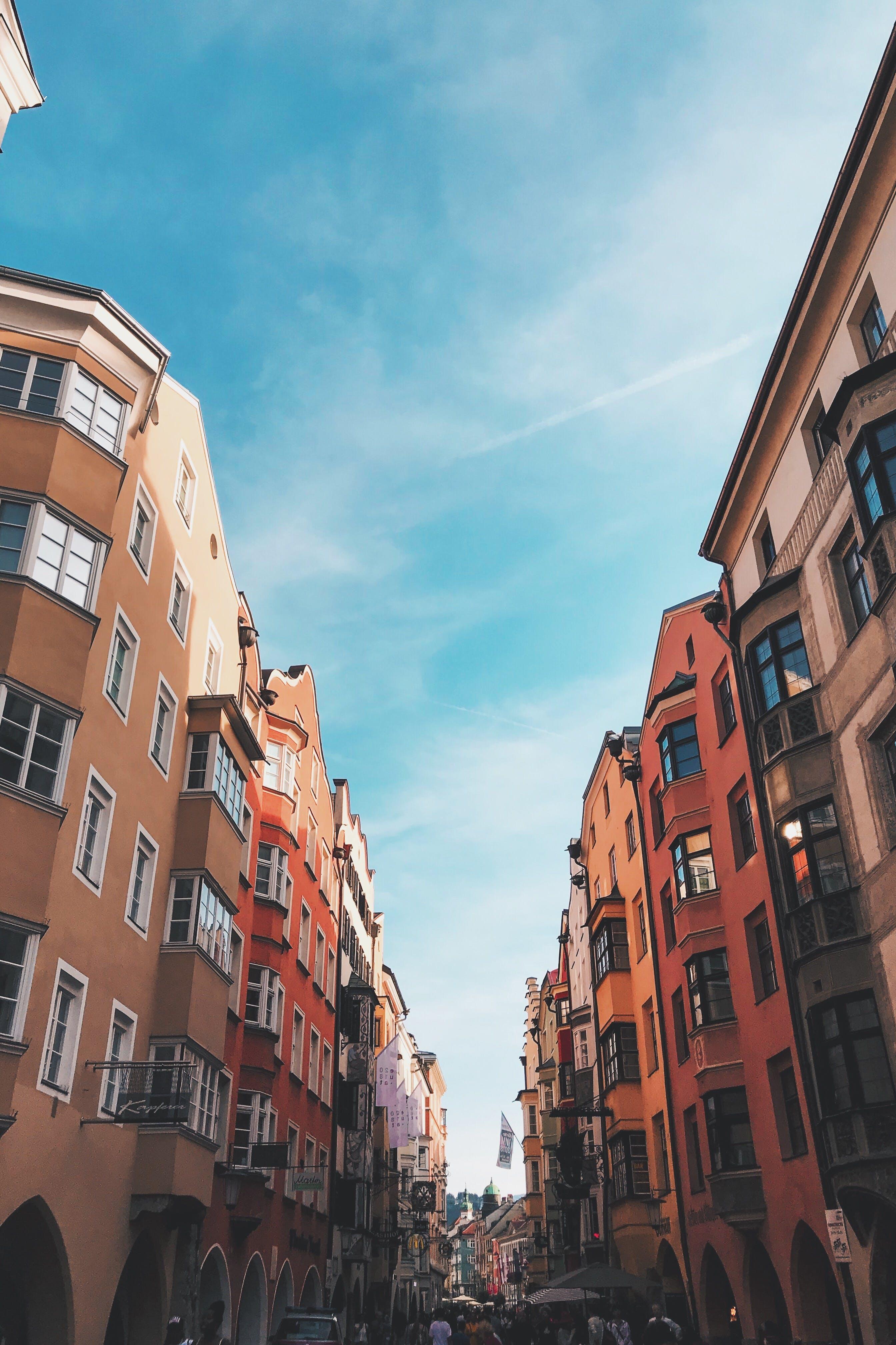 Photo of Street Between Buildings Under Blue Sky