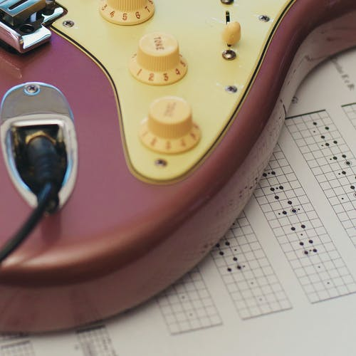Free stock photo of classic guitar, guitar, old guitar, pink and yellow guitar