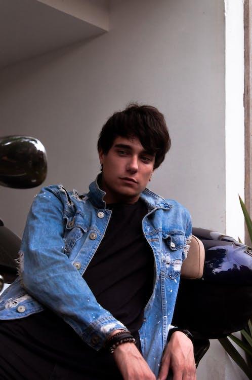 Photo of Man Wearing Denim Jacket