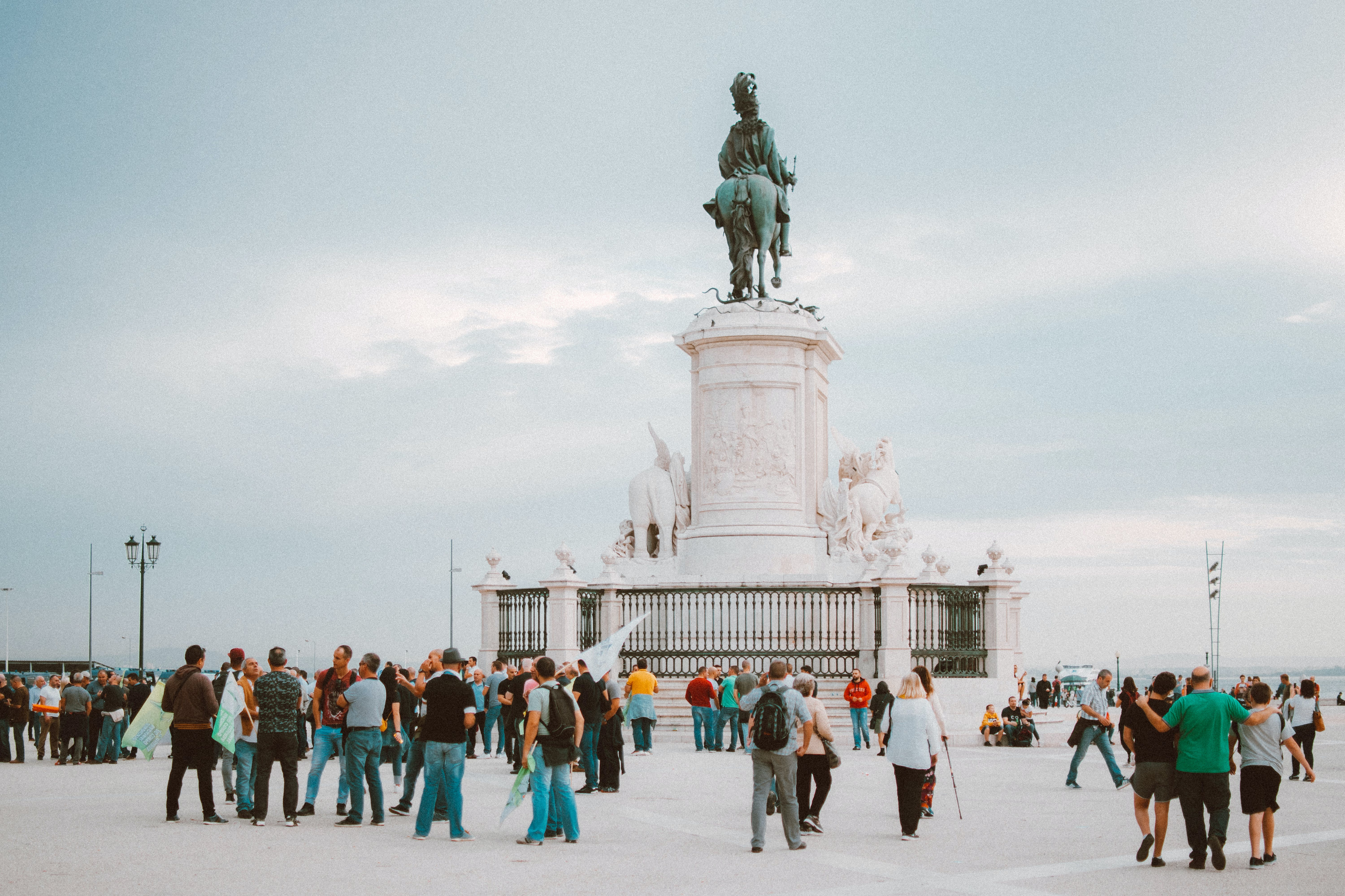 People Standing Near Statue