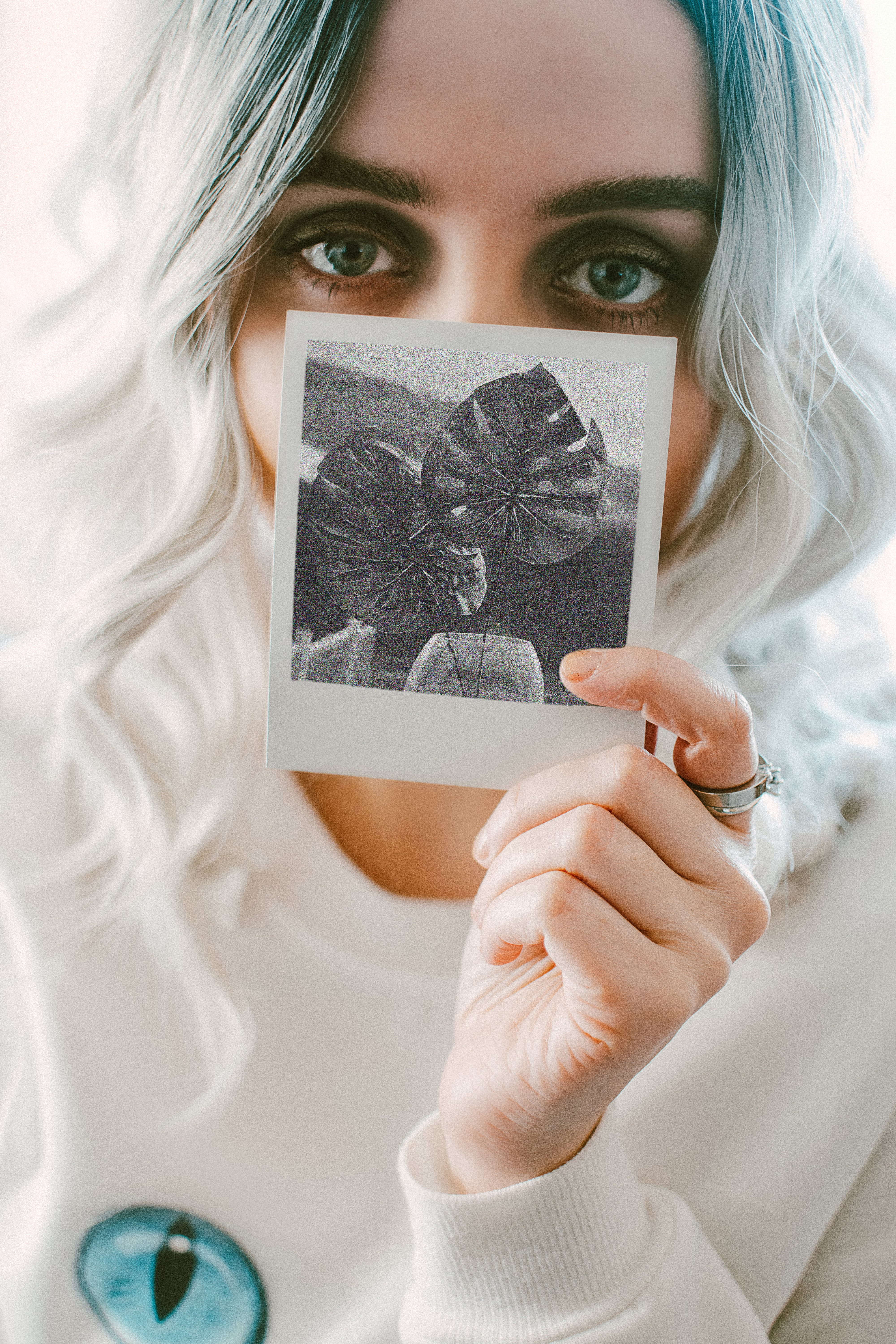Woman Holding Photo of Leaves