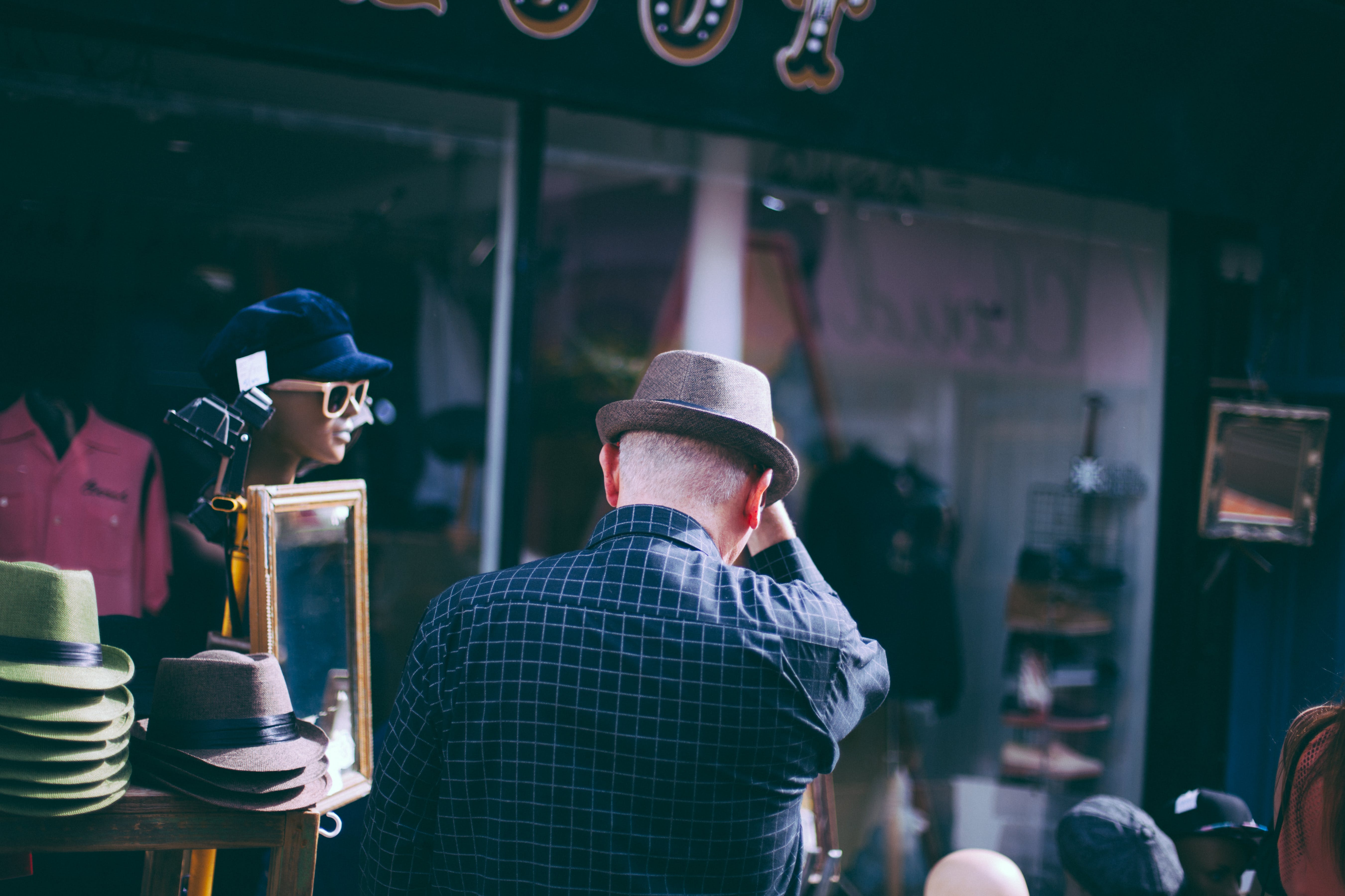 Man in Checkered Long Sleeve and Fedora Hat