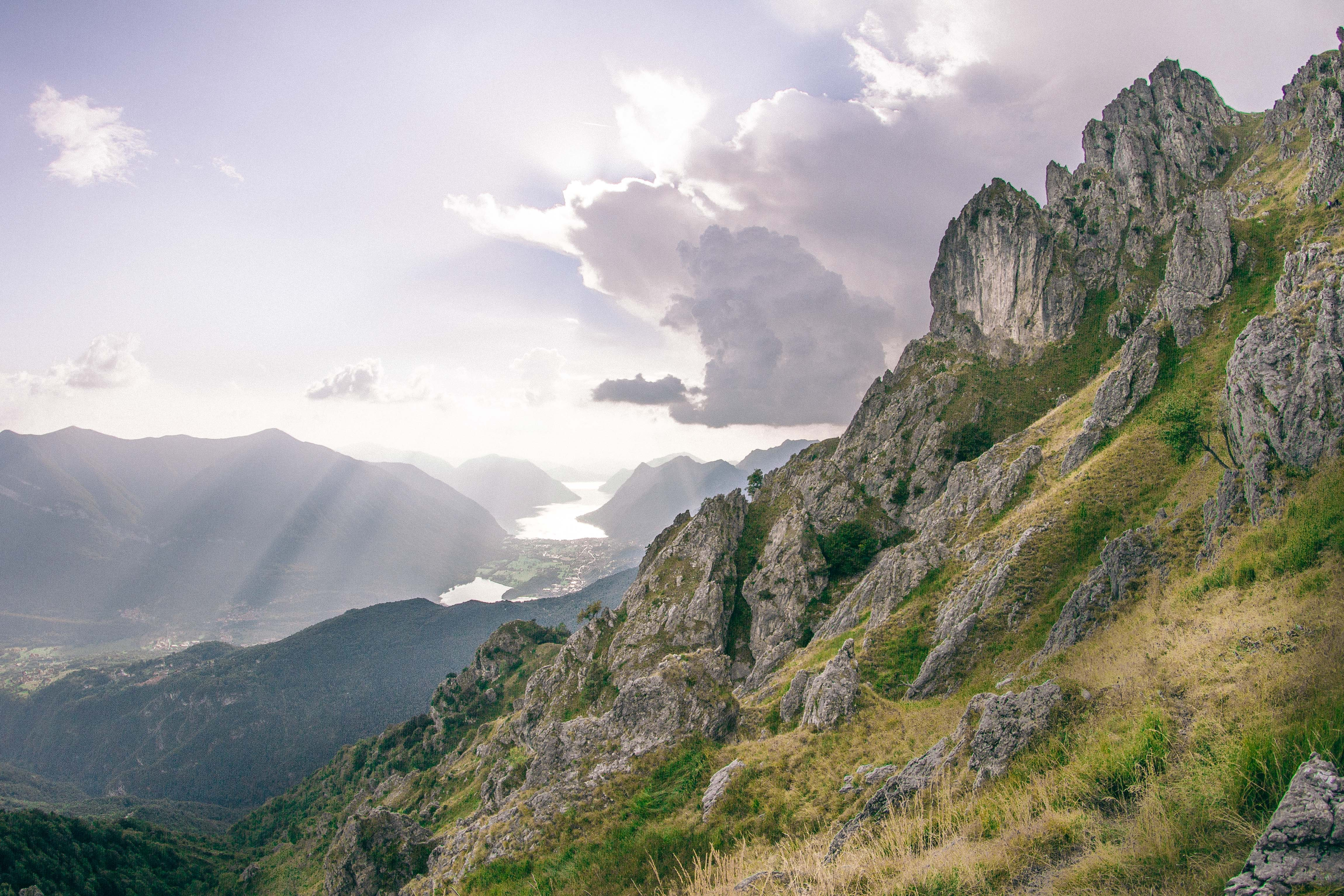 Low Angle Photography Of Gray Mountain Side Covered With