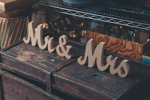 Gray Mr & Mrs Decors on Brown Wooden Trunk