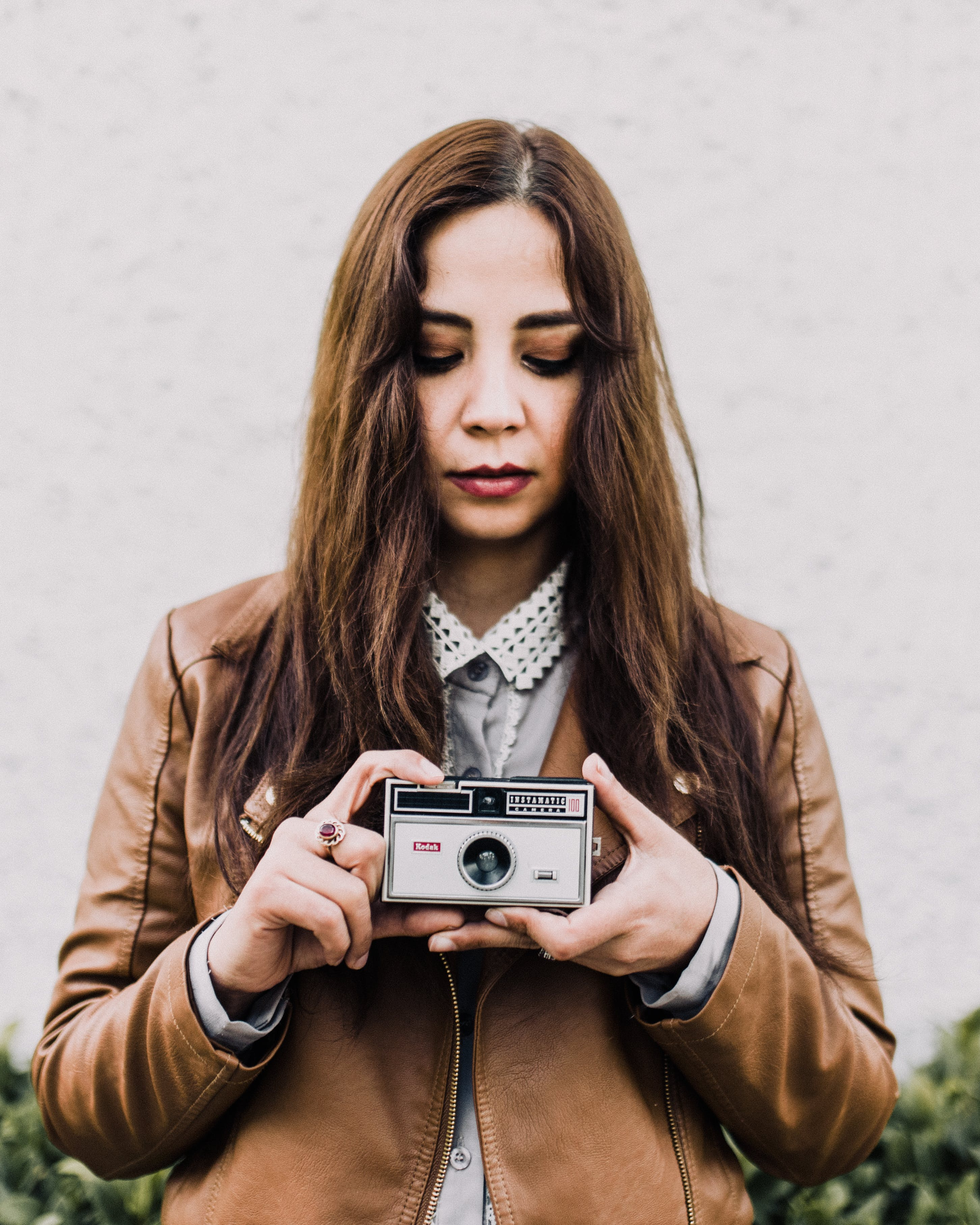 Woman Holding Gray Camera on Focus Photography