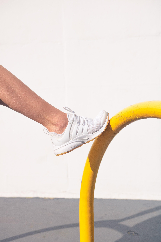 Person Wearing White Nike Shoe