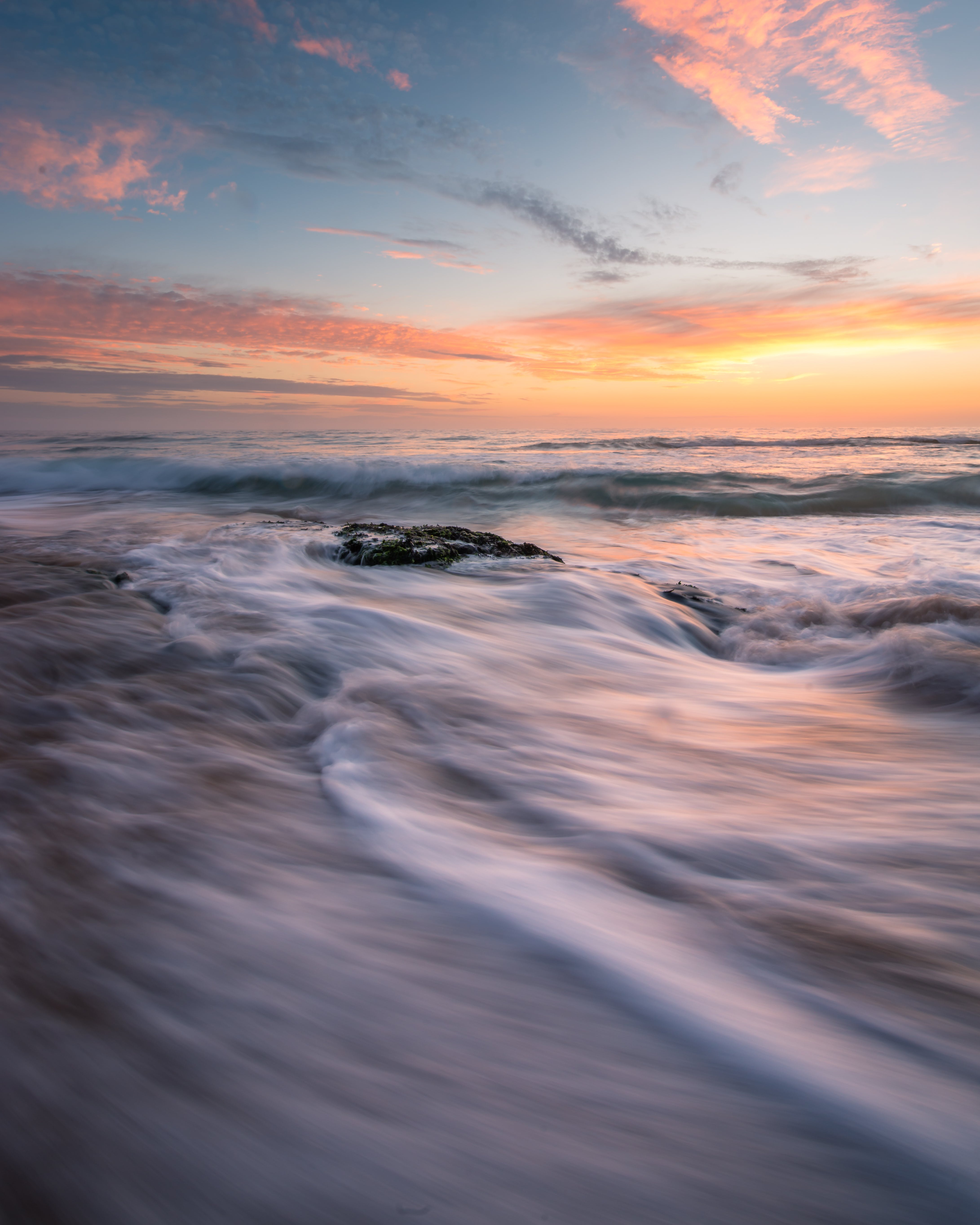 Long-Exposure Photography Of Ocean Wave During Golden Hour