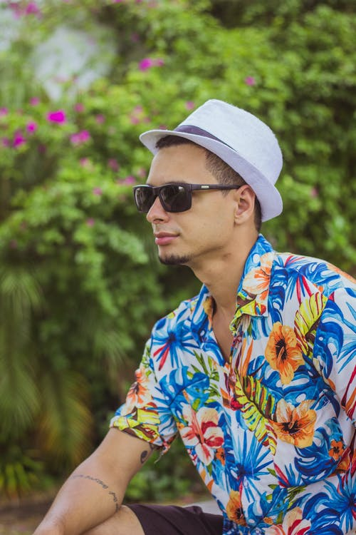 Man Wearing Black Sunglasses, White Fedora Hat And Floral Button-up T-shirt