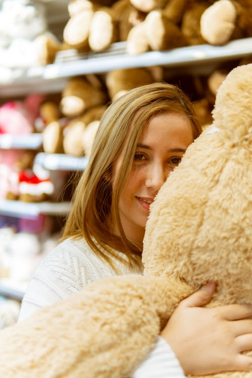 Woman Hugging A Teddy Bear