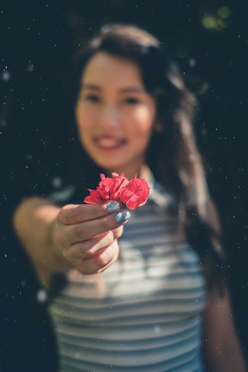 Woman Holding Bougainvillea Flower