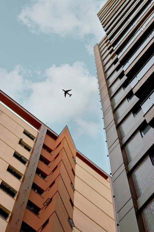 Airplane Above A Building