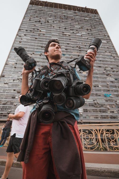 Man Carrying Dslr Cameras