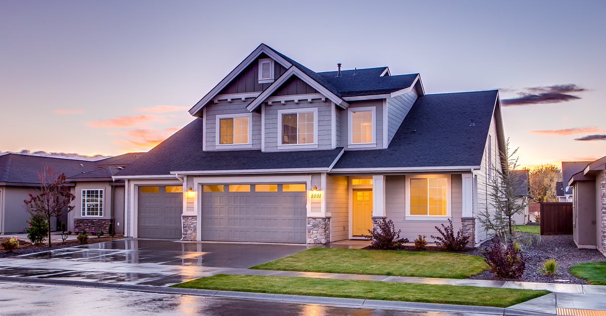 Blue and gray concrete house with attic during twilight for Free house photos
