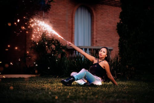Woman Holding Fire Cracker
