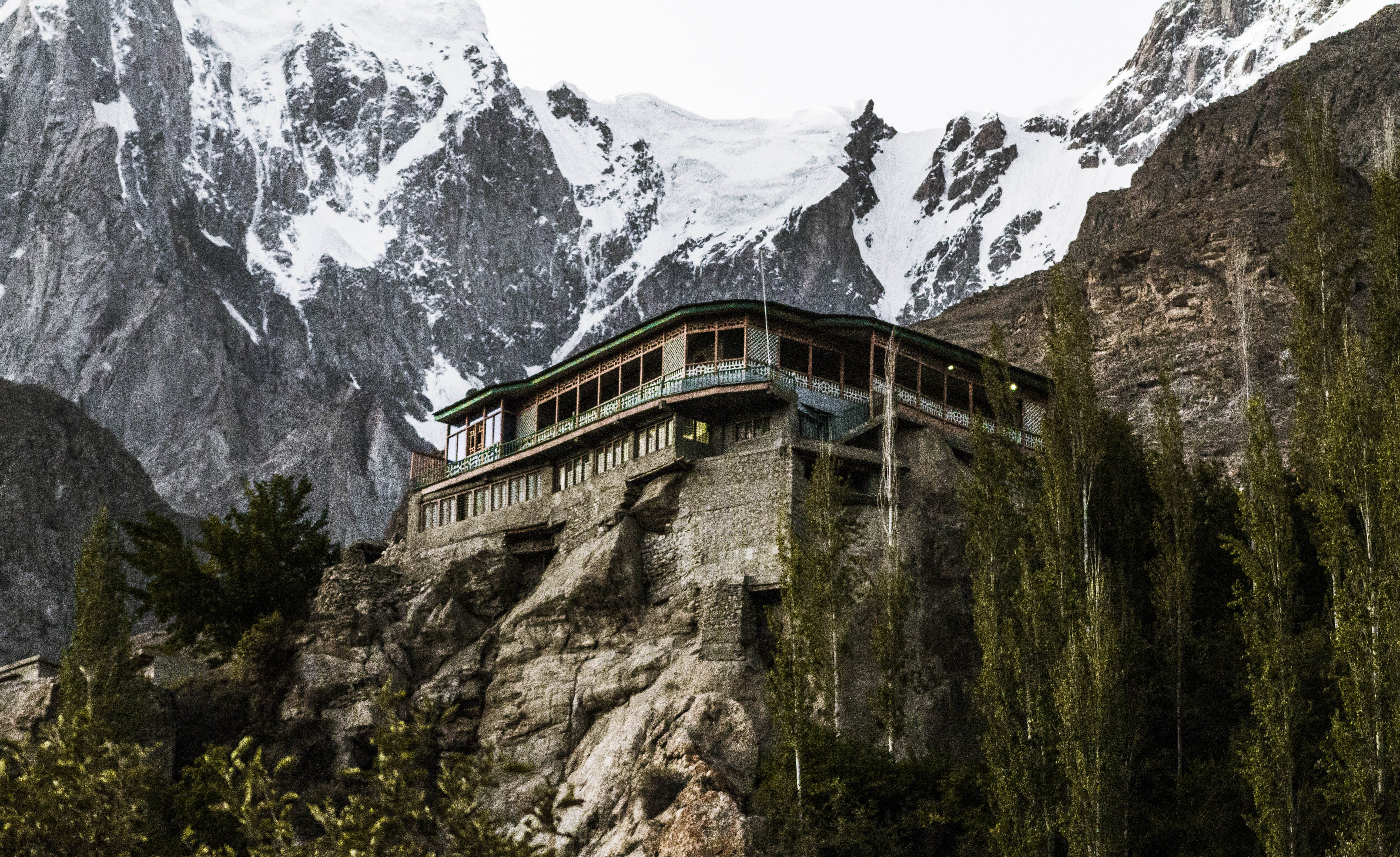 Gray and Brown Wooden House Near Mountain