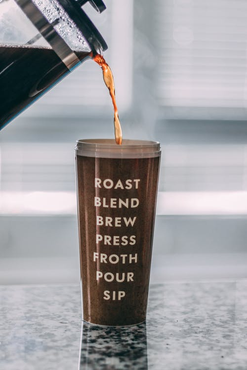 Brown Tumbler Filled With Coffee