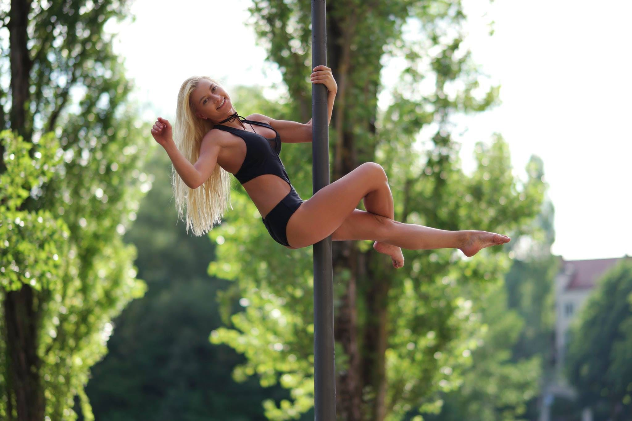 7 Unexpected Health Benefits of Pole Dancing - Woman Dancing on Pole