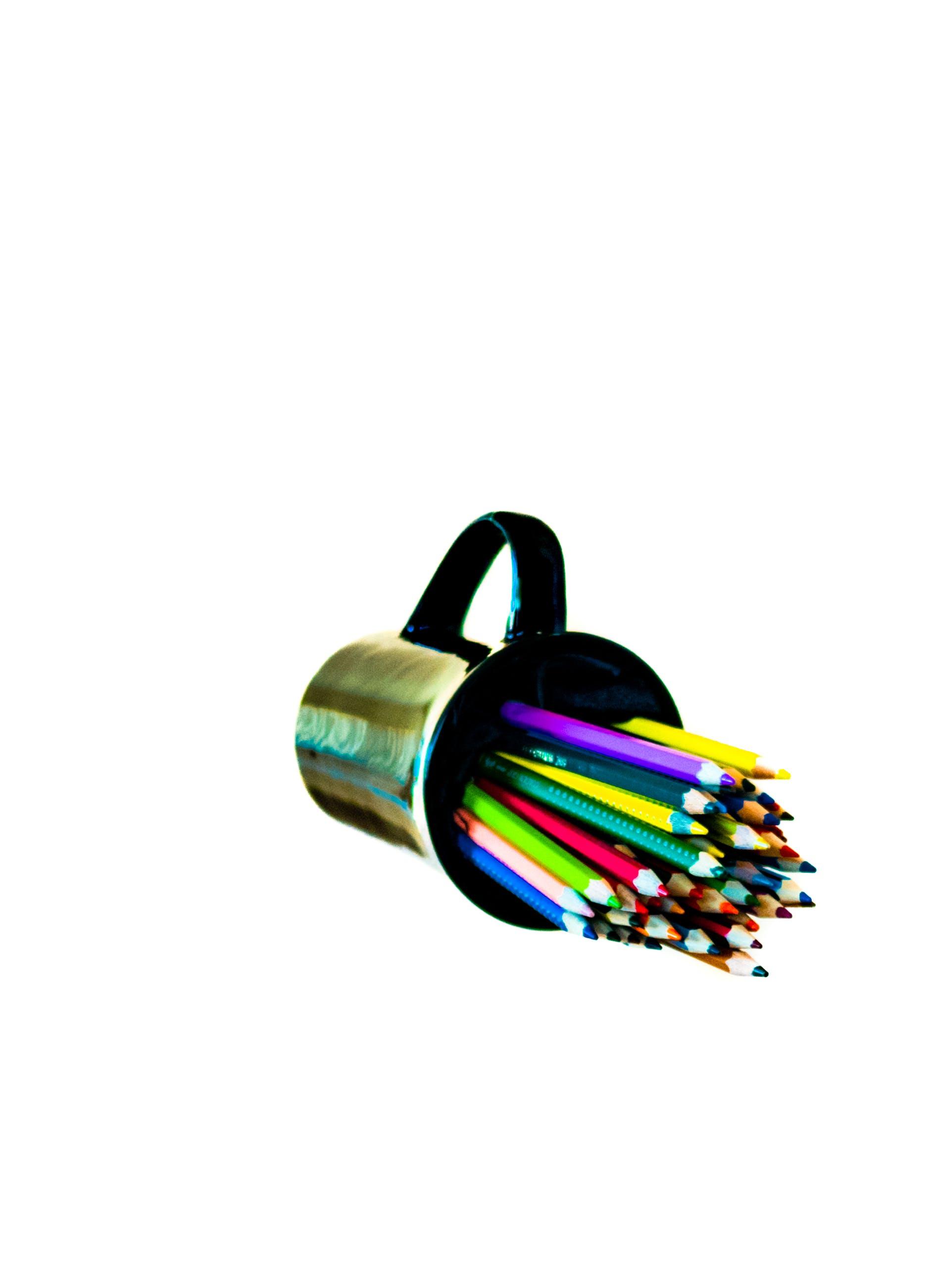 Free stock photo of black mug, coffee mug, coloured pencils, contrast