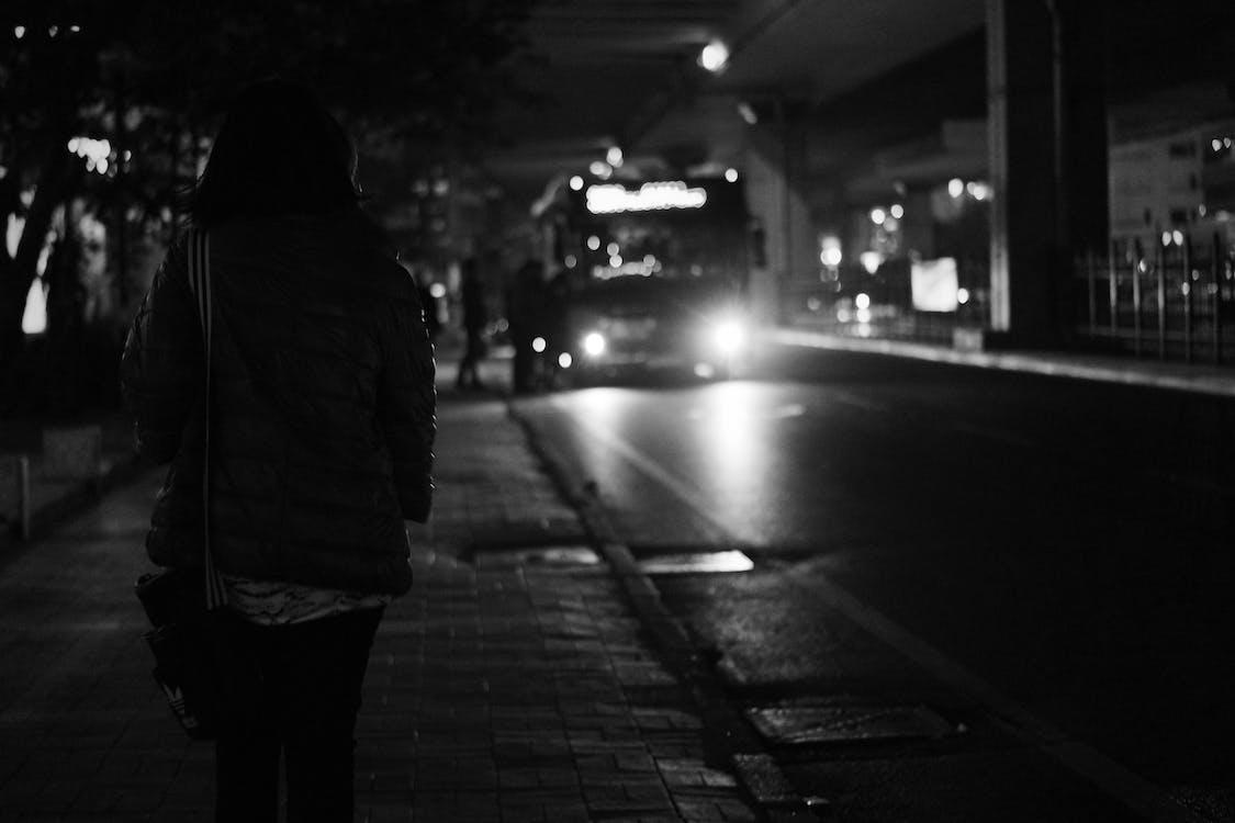 Black Bus Approaching during Nighttime