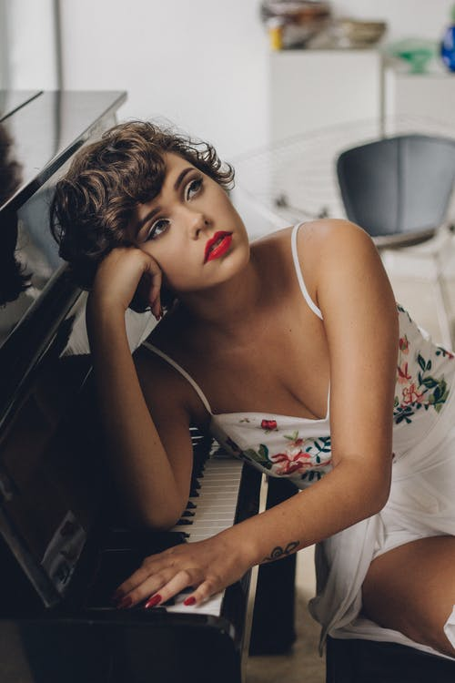 Woman Leaning on Piano