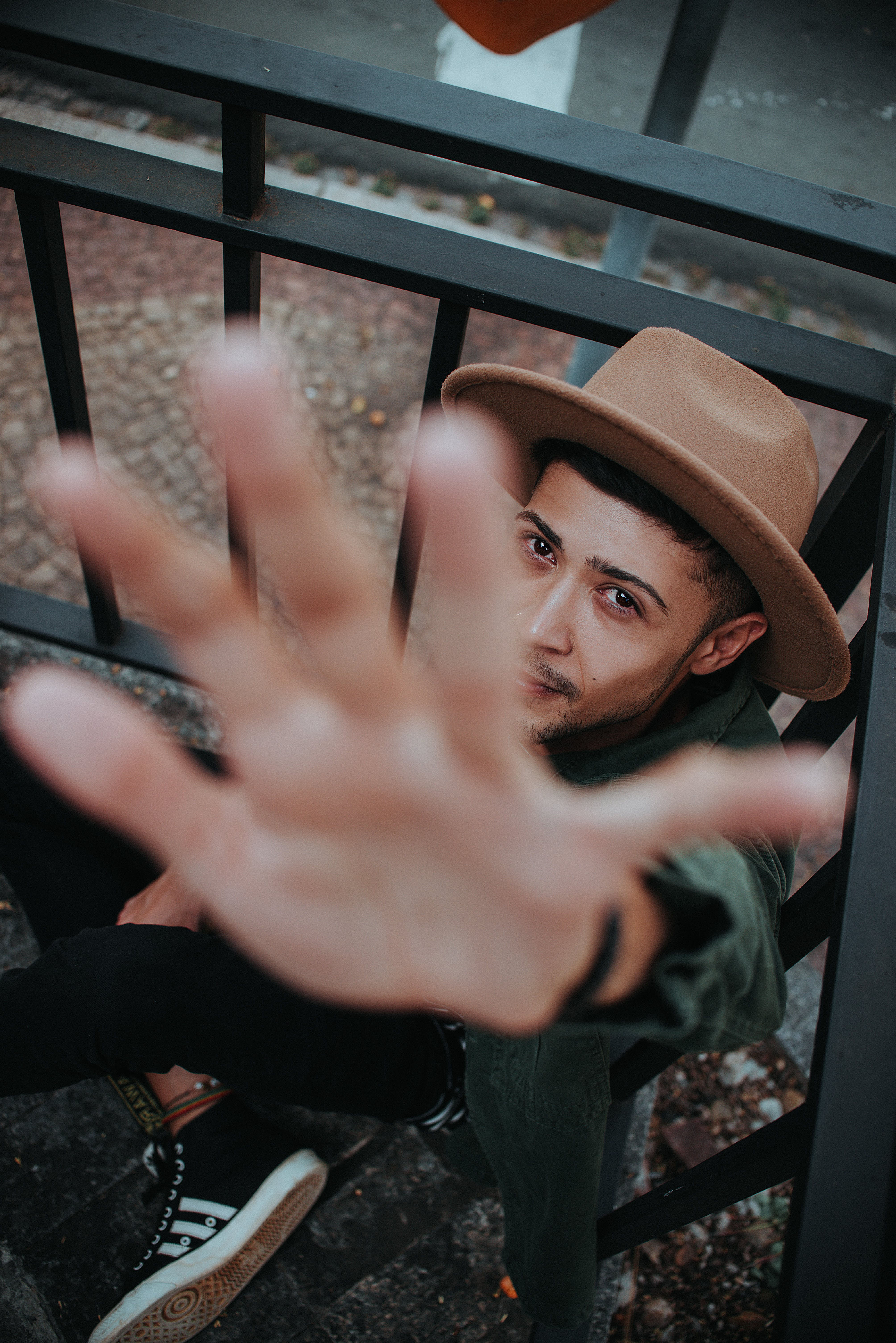 Man Wearing Fedora While Showing His Left Hand