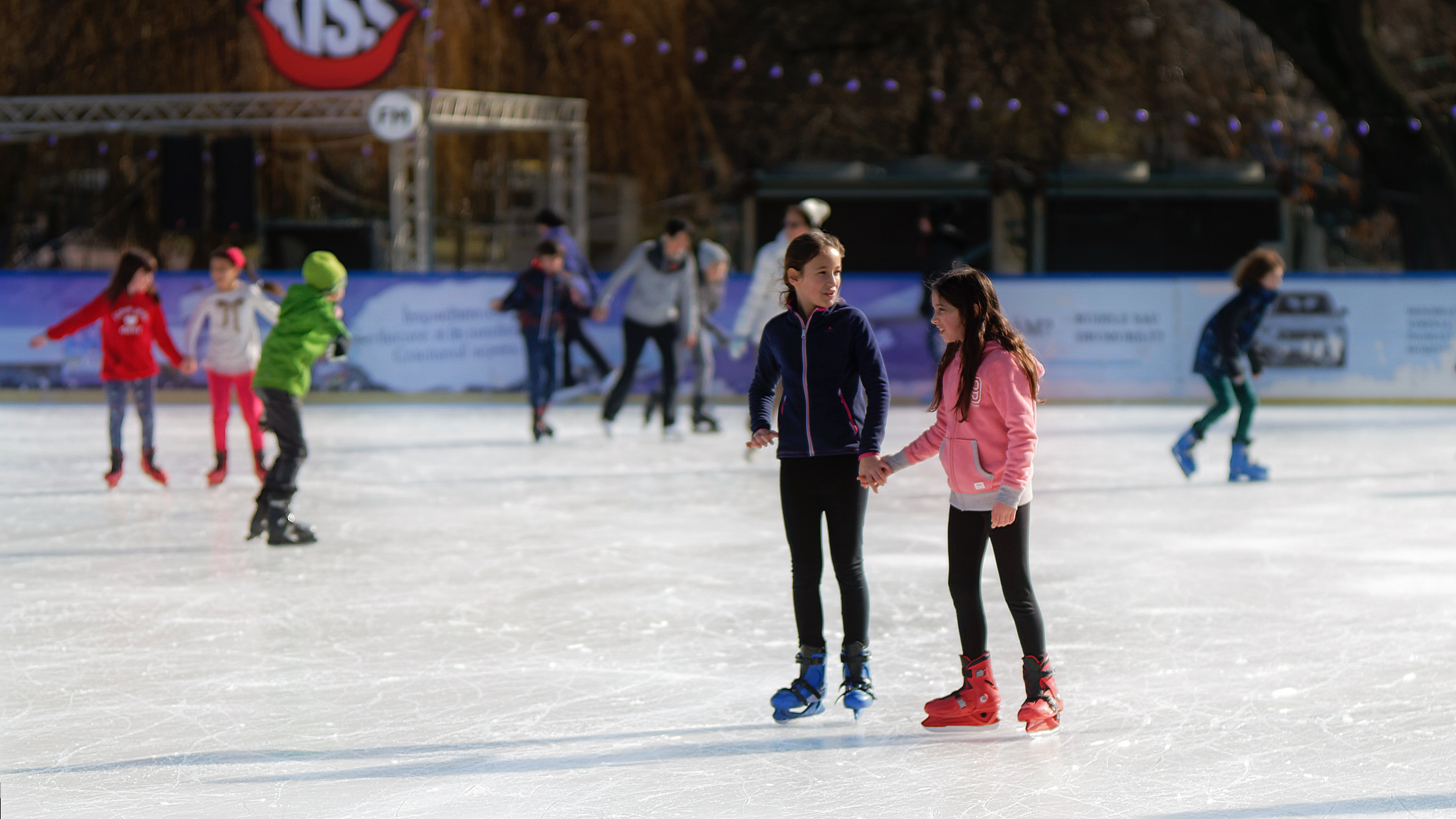 Free stock photo of children, ice skating rink, two young girls skating