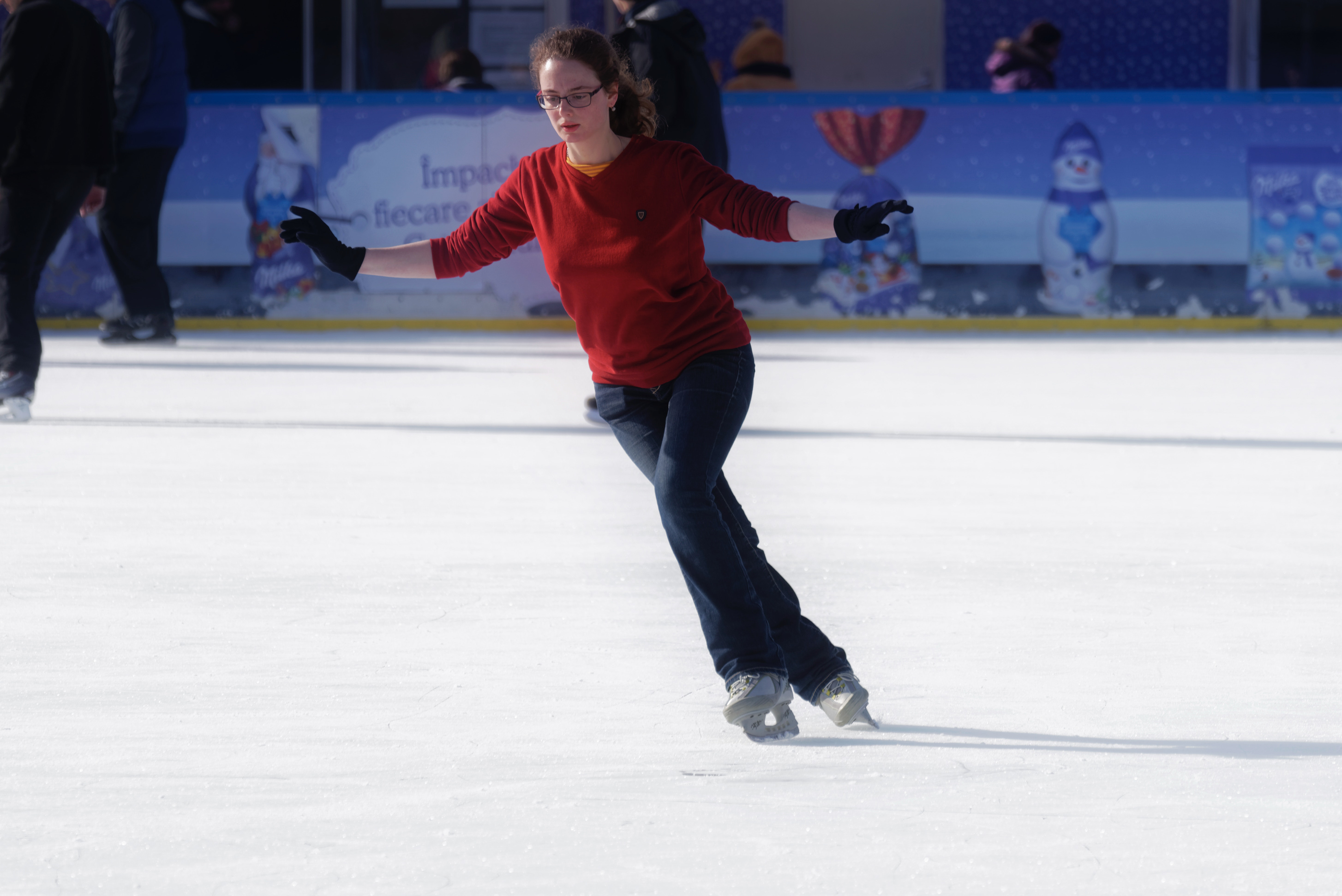 Free stock photo of performing, winter, young woman skating on ice skating rink