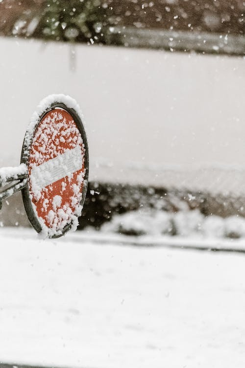 Red Stop Traffic Sign Covered in Snow