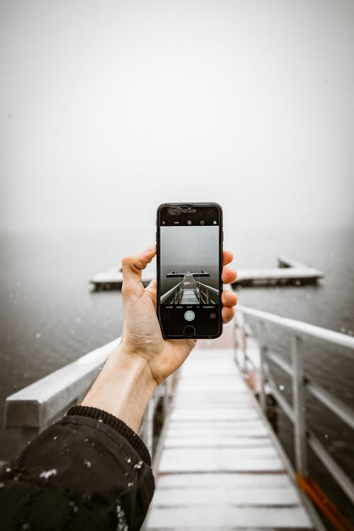 Person Taking a Photo of Dock