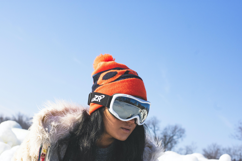Woman Snowboarding Beside Leafless Trees