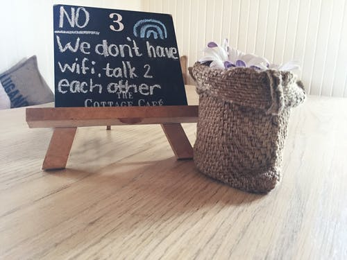 No 3 We Dont Have Wifi Talk 2 Each Other Text on Black Board