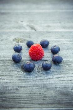 Raspberry Beside Blueberries